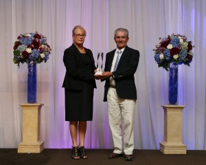 Andrea Magee, CHRHF Planning Committee presents Phil Hronec representing Eugene Melnyk`s Winding Oaks Farm with the award honouring thoroughbred mare Sealy Hill into the hall.