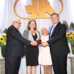 The late Robert Anderson was represented by his daughter Jessica Anderson Buckley and son David Anderson, seen here receiving the ring signifying their father's induction as a Thoroughbred Builder from Hall of Famer Mark Frostad and his wife Pam Frostad.
