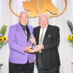 "Mine That Bird co-owner Dr. Leonard Bloch is presented the award for the Kentucky Derby's induction into the CHRHF from Peter Lamantia, co-breeder of ""Bird""."
