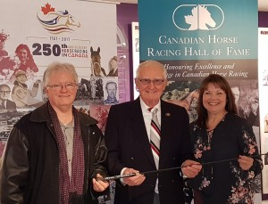 December 2017—CHRHF President John Stapleton and Managing Director Linda Rainey receive the Wewering whip from Bill Galvin on behalf of the CHRHF.